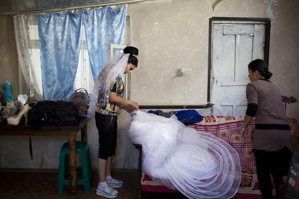 At a salon in the village, a bride gets ready for her wedding ceremony.