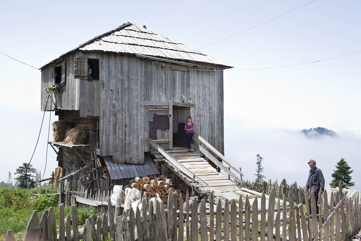 A Georgian family in the Adjara region lives in this house during the summers, a standard practice for farmers in the area. Usually, the houses are more than one hundred years old, and livestock lives on the first floor while the family sleeps on the second.