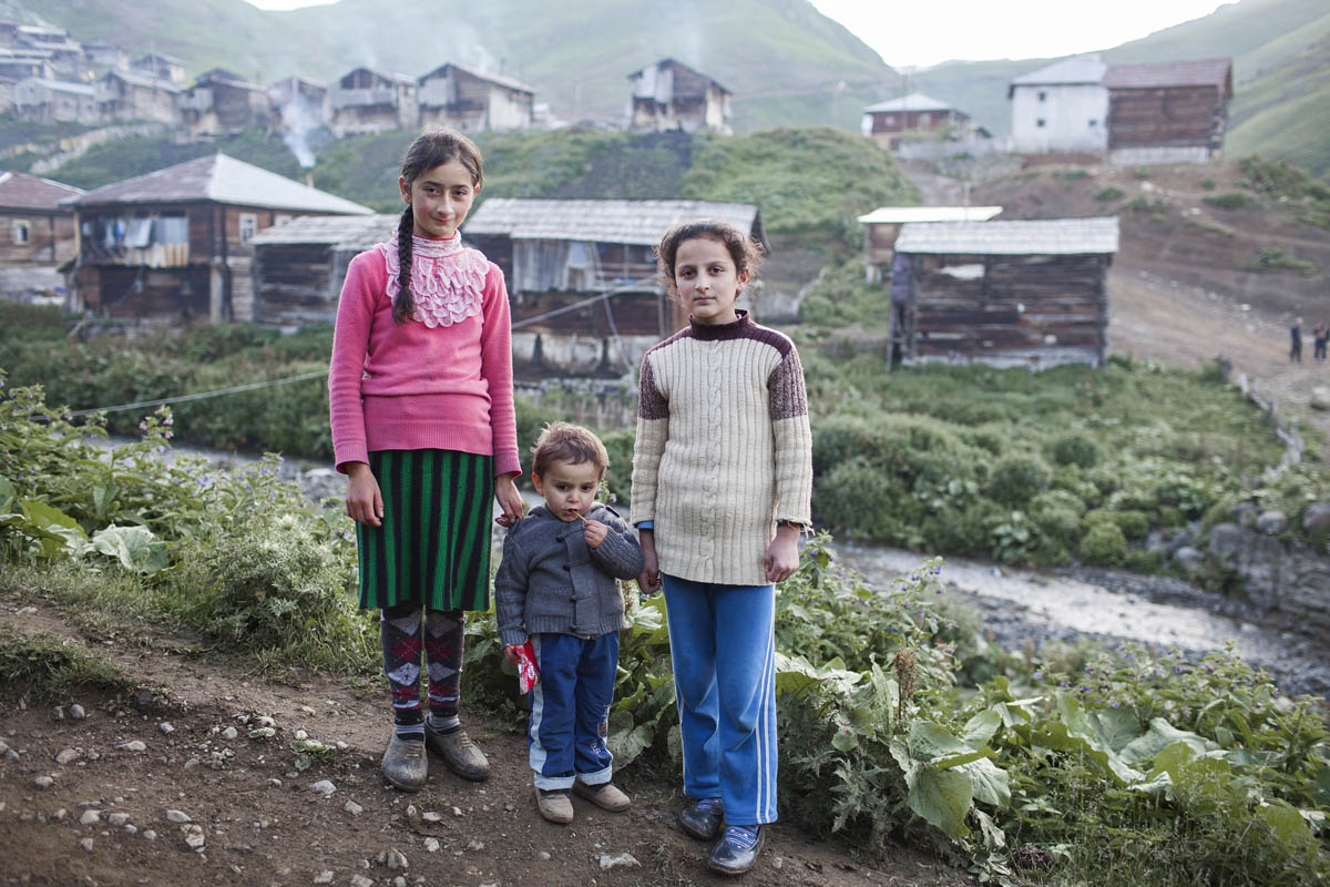 Children stand in front of a village in the Adjara region. Early marriages are very common in this region, many girls drop out of school to get married, following the footsteps of family tradition.