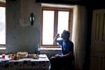 Georgia, Chiatura City. Mineworker Zaza, a father of 15 kids at home, drinking Tchatcha (Georgian vodka).