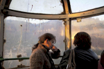 Georgia. Chiatura City.  Women riding home. Cable cars are dated back at Soviet era. It was build to tranport mineworkers up and down the mines.  60 years later it is still running and used as public transportation.