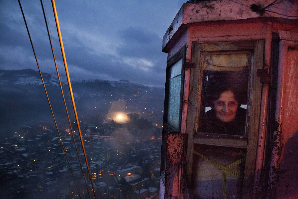 Georgia, Chiatura City. A cable car system dating back to the 1950s runs along the city's vast gorges. The cars were used to transport miners but today they are also used as public transportation for the locals. Here, a cable car controller works the night shift.