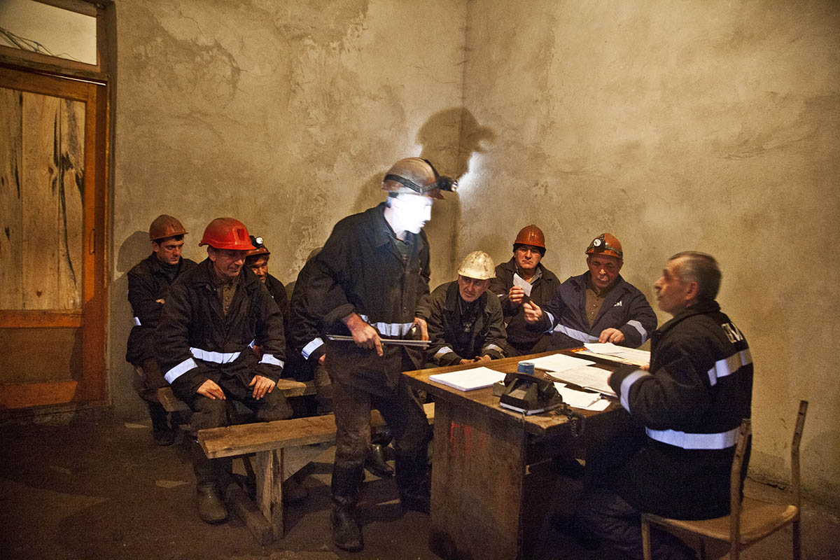 GEORGIA. The head of the shift, giving the miners their duty for the day, before they start working.