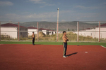 GEORGIA.  2010. Stadium, an afternoon after school. Tserovani. A New  village built by the Georgian government to house Georgians who were forced to flee South Ossetia when the Russians invaded.