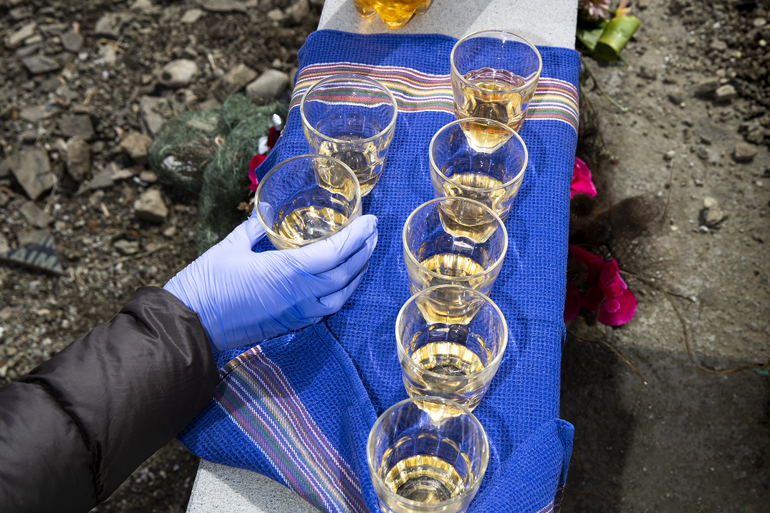 Our Georgian tradition, raising a glass of wine, saying a prayer, drinking the half of the glass and pouring the rest on the grave.  I would never imagine a close person to our family would pass away during the epidemic.