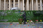 In front of the parliament. A local Georgian with flowers paying tribute to the 21 victims of the April 9 tragedy. My mom and dad were also present during the anti-soviet demonstration 31 years ago. Memorial looks sad during the crisis, but few people still came with masks.