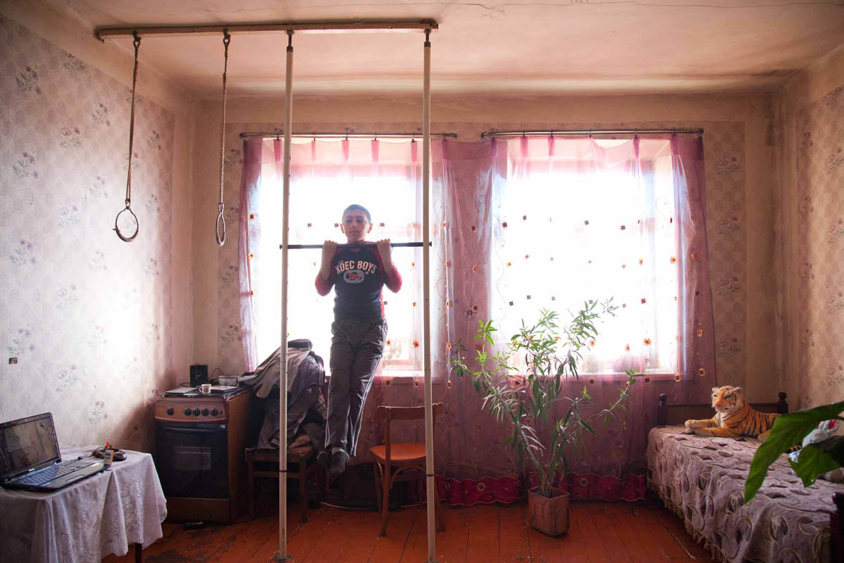 Georgia, 2012. Samtskhe – ­Javakheti region, Baraleti Village. Karen (9), armenian. Karen has won several medals in school championship for running. The region struggles with lack of employment and entertainment. Karen exercises everyday to become number one runner.