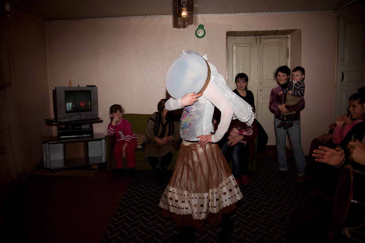 Georgia, 2013. Samtskhe­ – Javakheti region, Orja Village. Khanum (18) dances for her friends and neighbors at her house. Khanum was kidnapped twice for forceful marriage. Her father managed to get her back, regardless that it is considered a disgrace if the girl returns home after she has been kidnaped. She now sits at home and is unable to attend University, for her father fears that she will be kidnapped again.