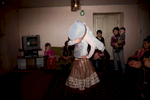 Georgia, 2013. Samtskhe – Javakheti region, Orja Village. Khanum (18) dances for her friends and neighbors at her house. Khanum was kidnapped twice for forceful marriage. Her father managed to get her back, regardless that it is considered a disgrace if the girl returns home after she has been kidnaped. She now sits at home and is unable to attend University, for her father fears that she will be kidnapped again.