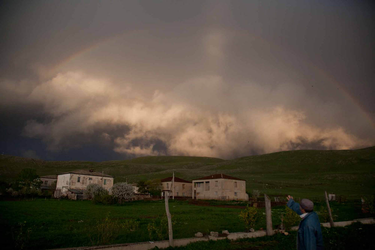 GEORGIA. 2012. Samtskhe-Javakheti Region. Village Kumurdo. Atcharian and Armenian settlement. Rainbow.