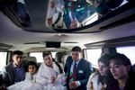 GEORGIA. Orja Village. Wedding ceremony. Inside a jeep hummer riding outside in a village of Orja as the groom and bride seat with their friends and relatives.