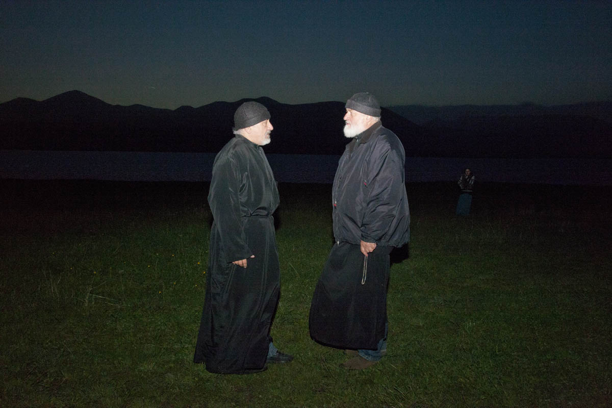 GEORGIA, 2012. Samtskhe–Javakheti region, Poka village. Two pilgrims near the Orthodox Church.