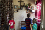 GEORGIA. 2017. Children stand in their home in Pakhulani village, on the southeastern border of Abkhazia. This village is the lesser-known of the two checkpoint crossings along the border.