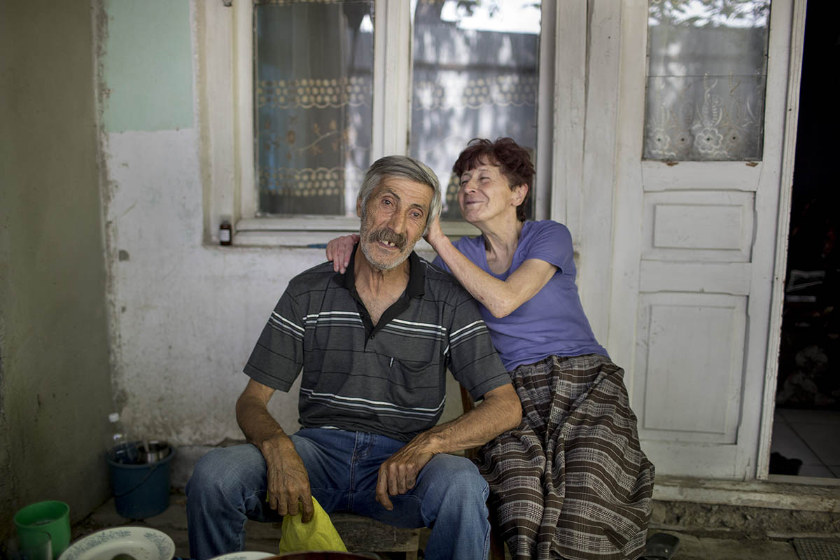 Lado (Georgian) and Mzia (Ossetian) been together for 35 years. They met at their mutual friends house. {quote}I saw her and planned to kidnap and marry her{quote}, said Lado. {quote}He still married me, even after the accident{quote}, Mzia had brutal car accident at a young age and never fully recovered.Living close to the occupied territory, after the war in 2008, they have made their way to South Ossetia to see their grandchild, though Mzia recalls that the stress was too much for her and she will not do it again.
