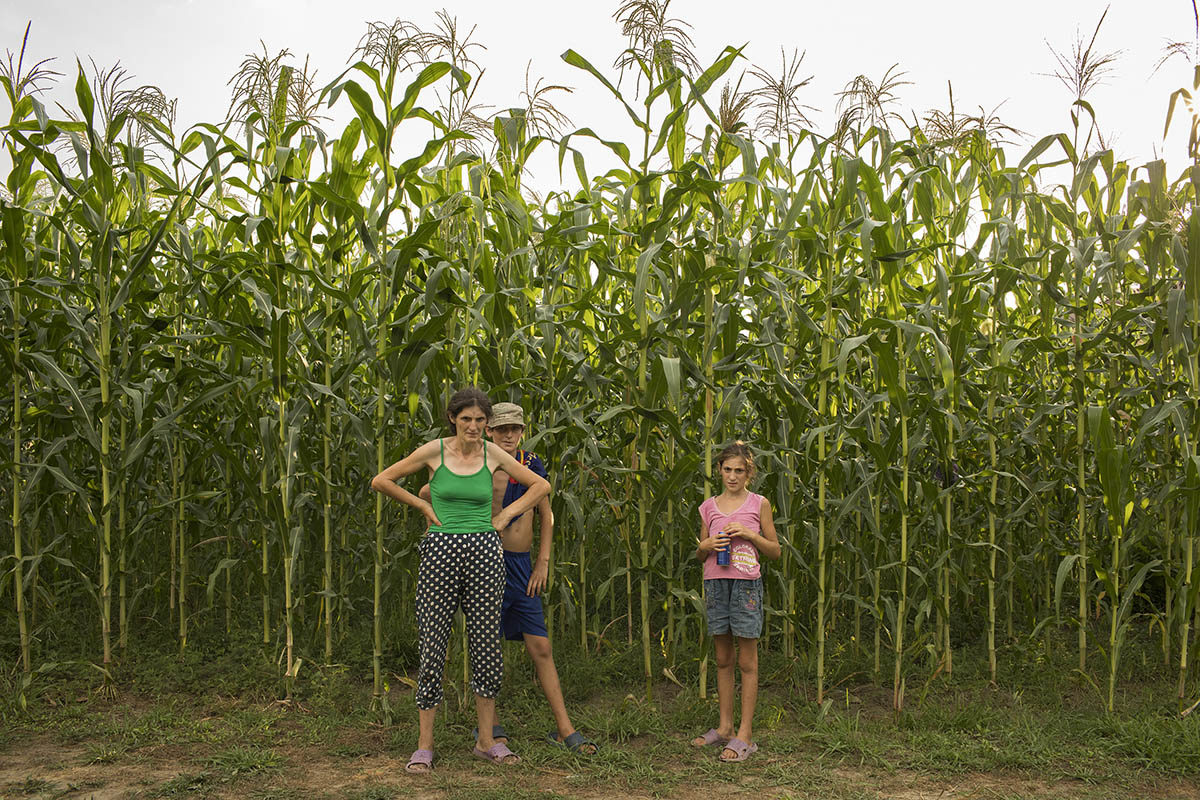 GEORGIA. 2017. A family stands near their corn field in Pakhulani village.