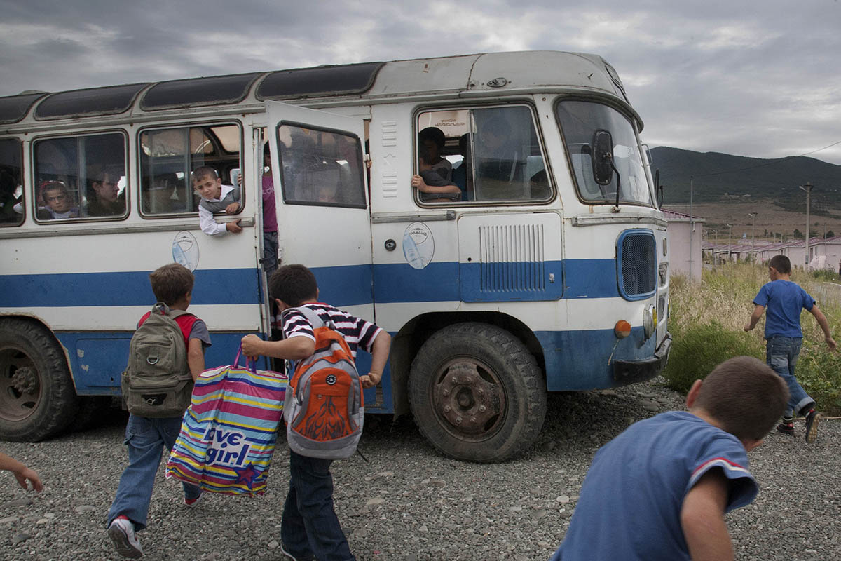 GEORGIA.  Children in Tserovani board a school bus.