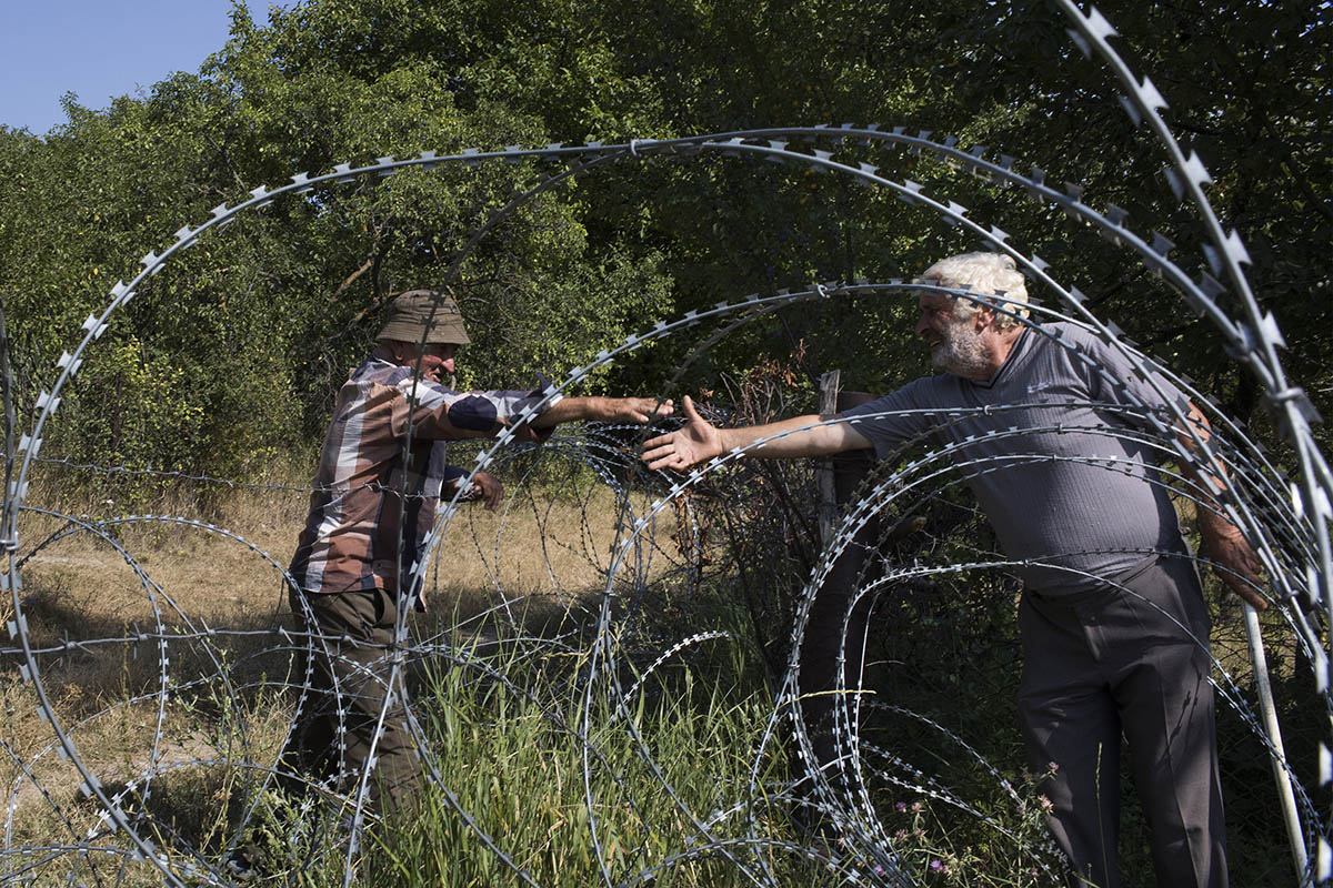 "2017. Georgia, Khurvaleti Village. Khurvaleti is one of the hot points of borderization by the Russians. Data ""Papa"" (grandfather) 84 y. old. Result of Russian borderization he is now living on the other side of the fence on the de facto region of South Ossetia, with his wife and son.  He can not buy bread on the de facto region with Georgian money, so he sometimes stands near the barbed wire fence and asks his neighbors on the other side of the fence to buy him a bread. ""I pass them money and they get me bread"". I voted in Georgia, going over the border line. When I got home, the Russian soldiers came to my house and jailed me. I had to pay a fine to get out, I asked the Georgian police and they helped. The payed 2000 rubles. Once I shaked hands with the president of Ukraine and Georgia when they paid me a visit, I do not know how the Russian found out, but once that happened, the Russians once again came to my house blackmailing me. I was jailed twice. This is not a life to live. I am confused. I woke up discovering myself not in Georgian controlled territory, but in the hands of the Russians"". Quotes Data."