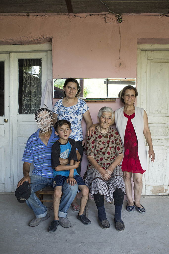 2017. Georgia, Khurvaleti Village. Khurvaleti is one of the hot points of borderization by the Russians. The Family which wishes to not name them, live right near the barbed wire fence. Their house wall is leaning on the border of the de facto region of South Ossetia. {quote}Erase my name on the photo, because you never know, they borderization is taking place in my back yard{quote}, says the man seating on the left side of the photo.