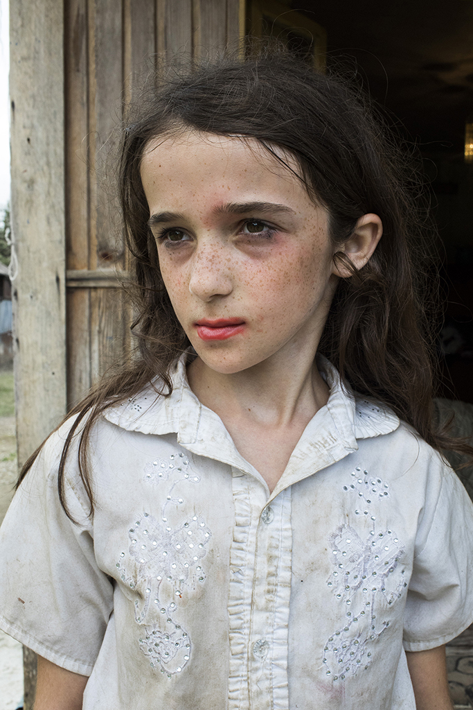 2017. Georgia, Khurcha Village. Nino 12 years old with make-up on her face. Nino and her 8 Siblings have status of refugees from Abkhazia, as their mother is from Gali region.