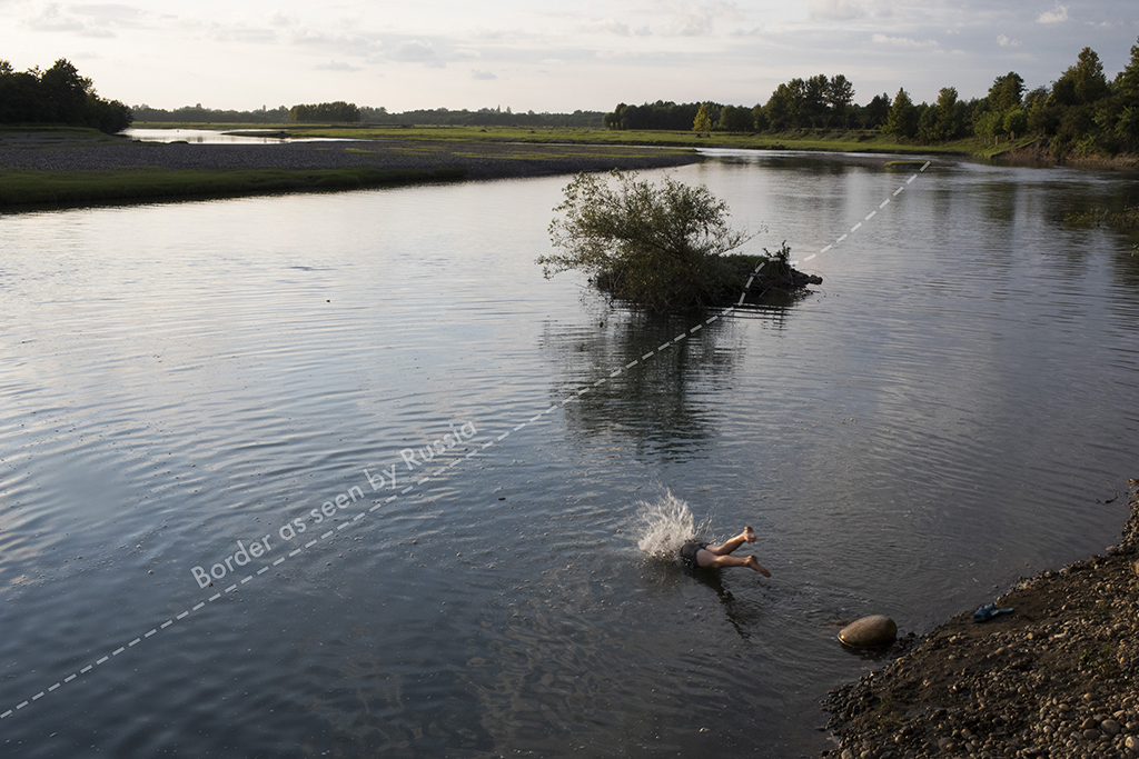 2017. Georgia, Orsantia Village. A child takes a swim in the Enguri River, which is used as the borderline of the Russian-supported separatist territory of Abkhazia. The river was previously known as a good location for safely crossing into Abkhazia, but recent installation of barbed wire fencing and surveillance equipment has stalling those crossings.