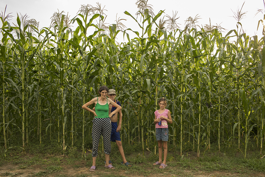 2017. Georgia, A family stands near their corn field in Pakhulani village.