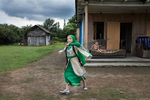 2017. Georgia, Nine-year-old Nana plays in her yard in the village of Khurcha on the southeastern border of Abkhazia. One of eight siblings, she is a folk dancer who hopes to become famous.