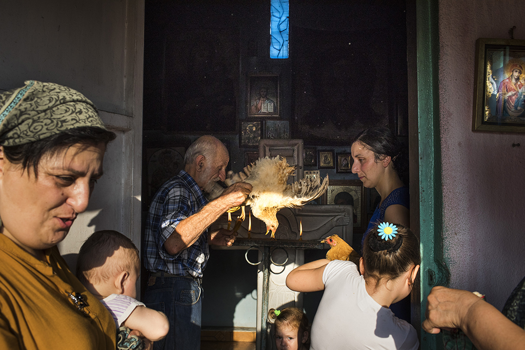 2017. Georgia, Residents of the village of Khurcha participate in a church ritual. Prior to March 2018, the village was one of the main checkpoints in and out of Abkhazia. It has now become more isolated.