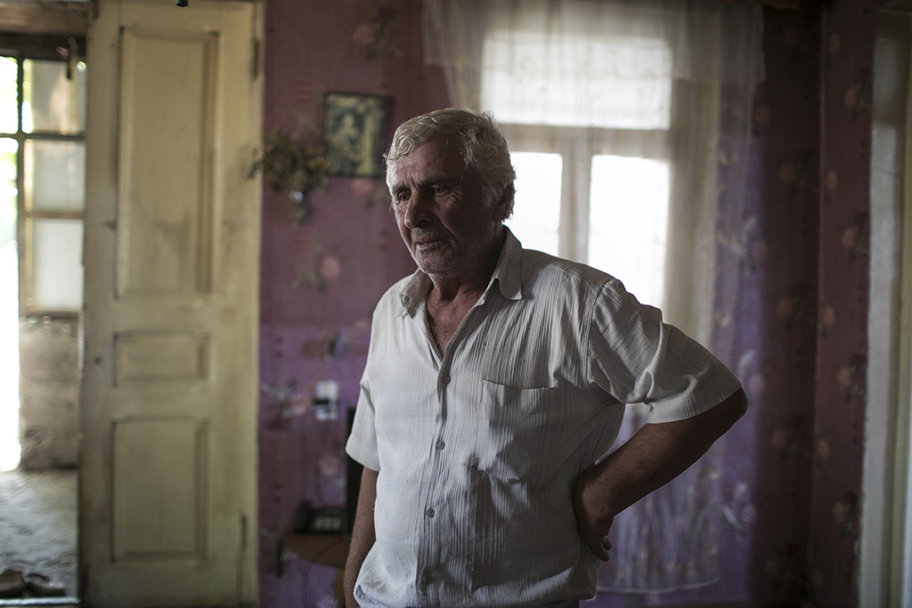 2017. Georgia, Otari stands in his home in Khurvaleti village, near the southern border of South Ossetia.(Otar passed away in 2019).
