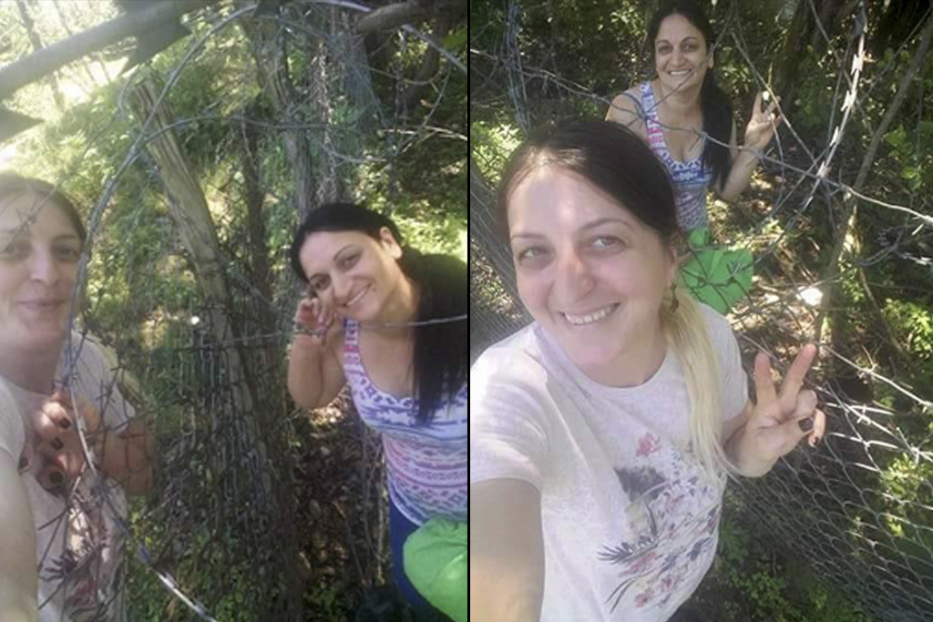 2017. Georgia, Selfies of best friends seperated from each sides of the Enguri river. Khurcha village is controlled by Georgia, while Nabakevi village is now a base of  Russian forces on the de facto region of Abkhazia. Once in a while they call each other on the phones and meet near the barbed wire fence.