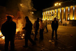 GEORGIA. 2009. Protestors burning garbage outside the Parliament to keep themselves warm.Mock prison cells set up by opposition protesters in Tbilisi, in front of the Parliament. Opposition built the cells as symbolic of the {quote}police state{quote} they say Georgia has become under Saakashvili since he came to power on the back of the 2003 Rose Revolution.The 2009 Georgian demonstrations were a mass rally by an ad-hoc coalition of opposition parties in Georgia against the government of President Mikheil Saakashvili. Thousands of people demonstrated, mainly in Tbilisi, demanding Saakashvili's resignation. On the first day of demonstrations, up to 60,000 people gathered in Tbilisi.  Protests continued for over three months.