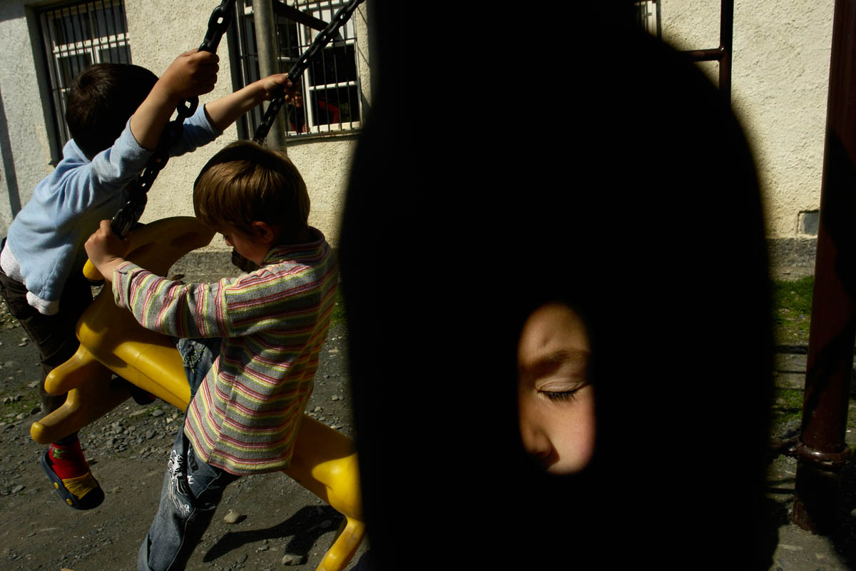 GEORGIA. Pankisi Gorge, a Chechen refugee settlement. Kindergarten. Chechen refugee boys on the playground.