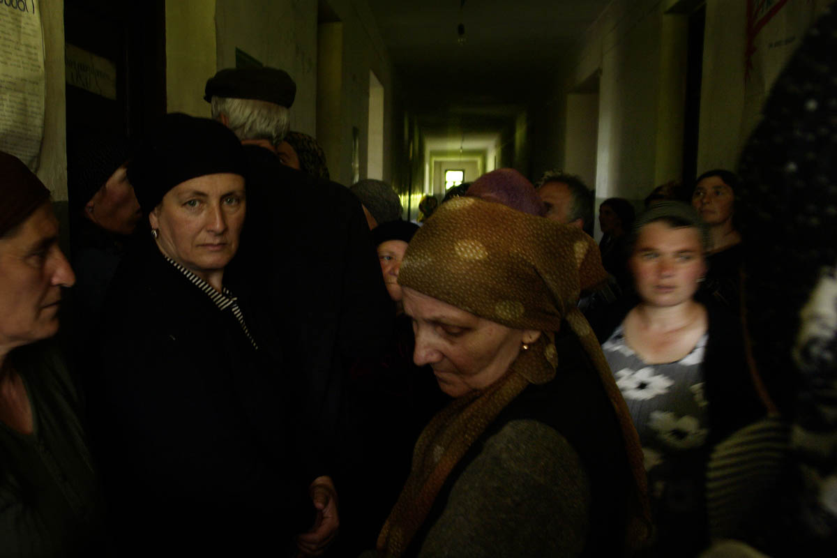 GEORGIA. Pankisi Gorge, a Chechen refugee settlement. Local Mayor Elections. Chechen women in line hoping to get a chance to vote. A school building.