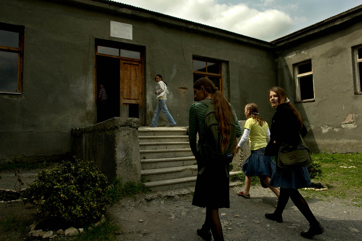 GEORGIA. Pankisi Gorge, a Chechen refugee settlement. School. Young Chechen girls heading to school. The school has no more then 50 students.
