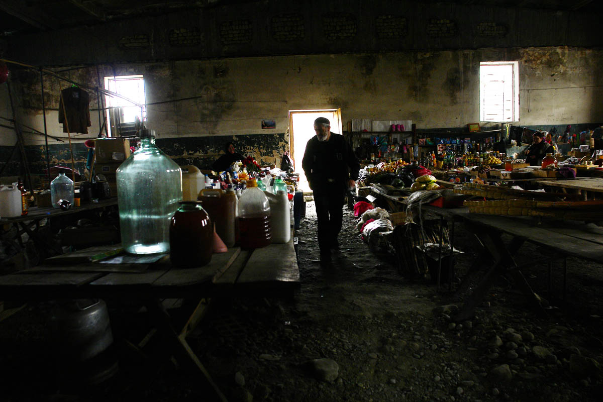 GEORGIA. Pankisi Gorge, a Chechen refugee settlement. 2008. Market. Only marketplace in Pankisi where everything is sold, from coke to nails. You can even find a Barbie doll.