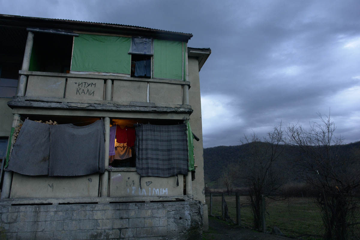 GEORGIA. Pankisi Gorge, a Chechen refugee settlement. An old hospital, built during the Communism period in Georgia, now a home to several Chechen refugee families.