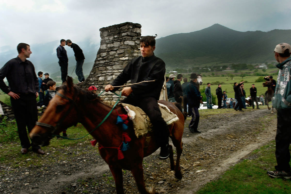 GEORGIA. Pankisi Gorge, a Chechen refugee settlement. May. 2008. Chechen Boys. Pankisi has no jobs for the young men to start working. Without any money, they cannot step outside Pankisi. Because the Georgian government has not yet supported them with any legal documents, it's impossible for them to search for jobs in the city.