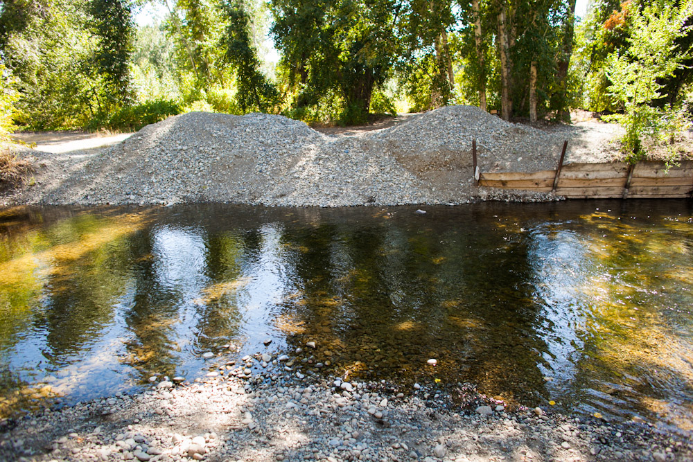 In the Fall, the Wood River Irrigation Disctrict closes the headgate and backfills their canal with gravel as a second measure to prevent water from continuing on.  While effective, a better, cleaner, and safer solution is surely able to be devised that would increase the appeal of this section of the park.