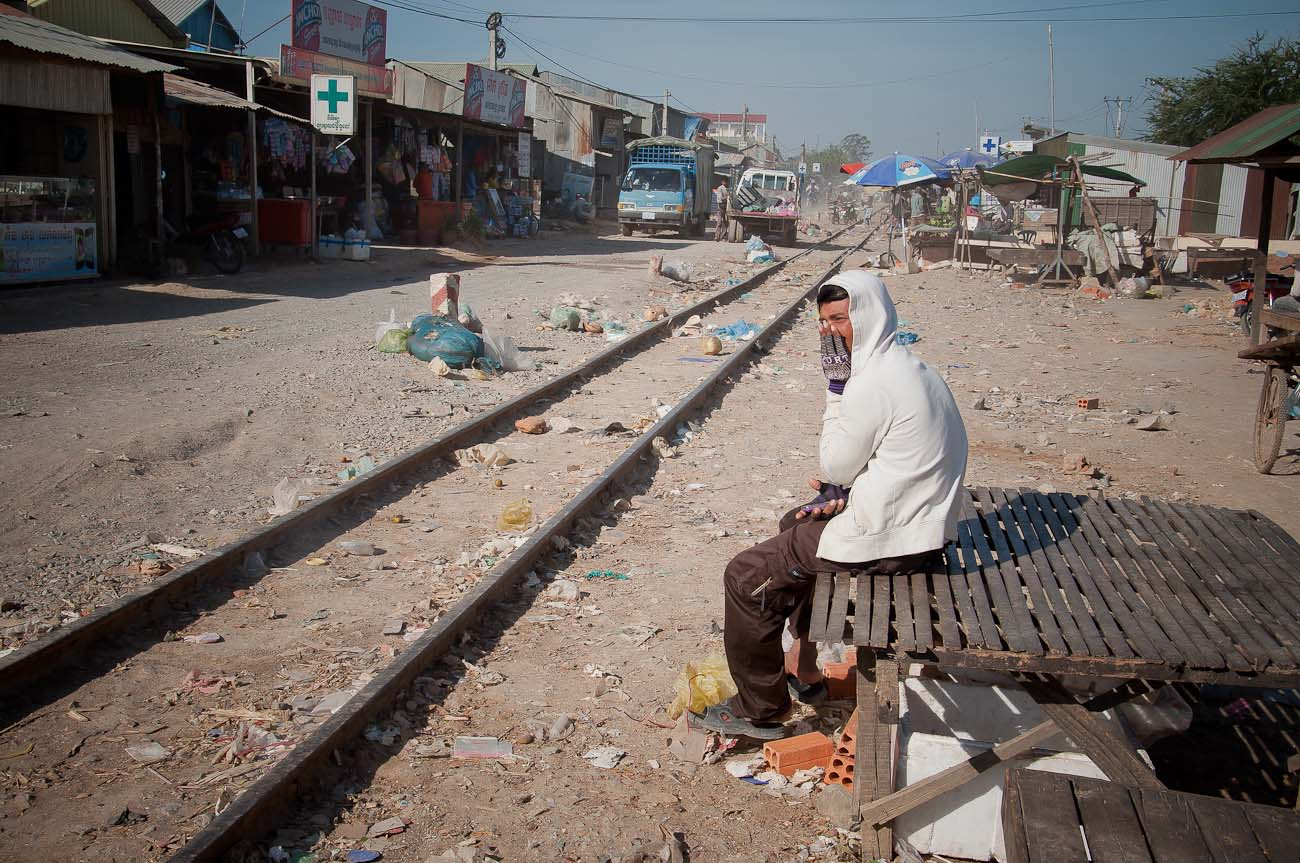 A market near the New World mega housing project on the outskirts of Phnom Penh. The railway line hasn't been in operation for many years. Cambodia is one of the few countries in SE Asia without a railway system. December 2011