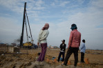 Construction workers survey the land at the New World mega housing project on the outskirts of Phnom Penh. December 2011