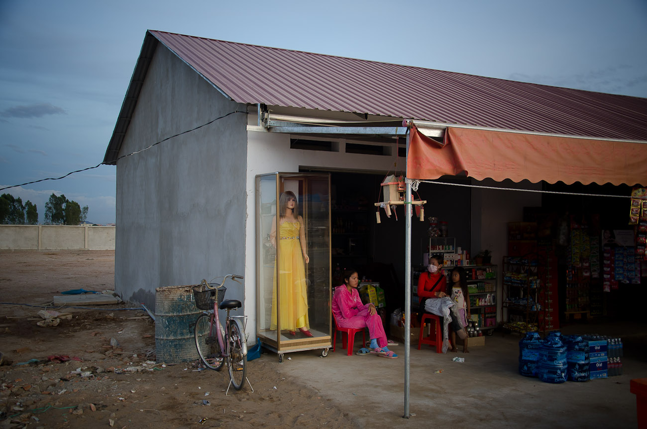 A general store that provides goods for the workers at the New World mega housing project on the outskirts of Phnom Penh. They are mostly from the country side and earn anywhere between five to ten dollars per day depending on their skills. December 2011