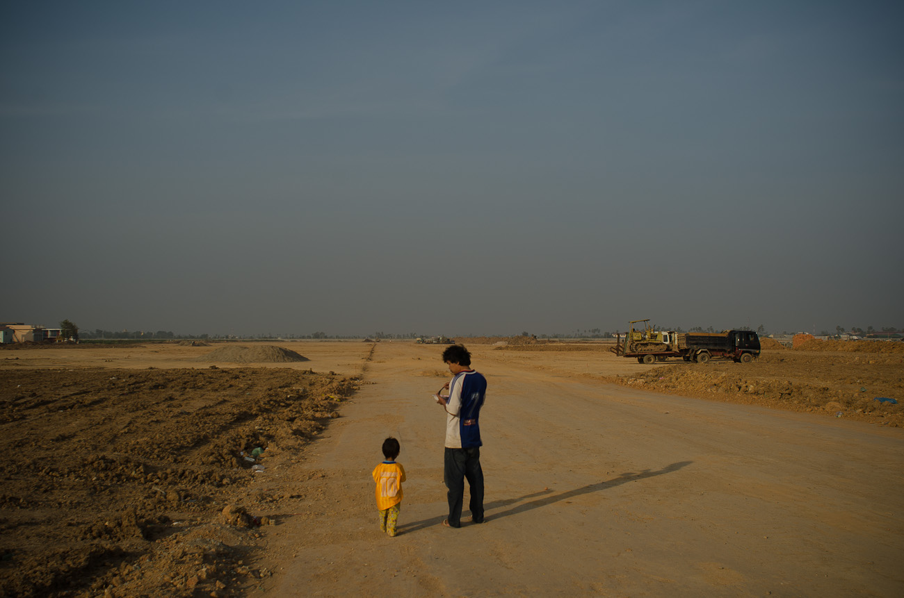 Workers outside of the New World mega housing project on the outskirts of Phnom Penh. December 2011