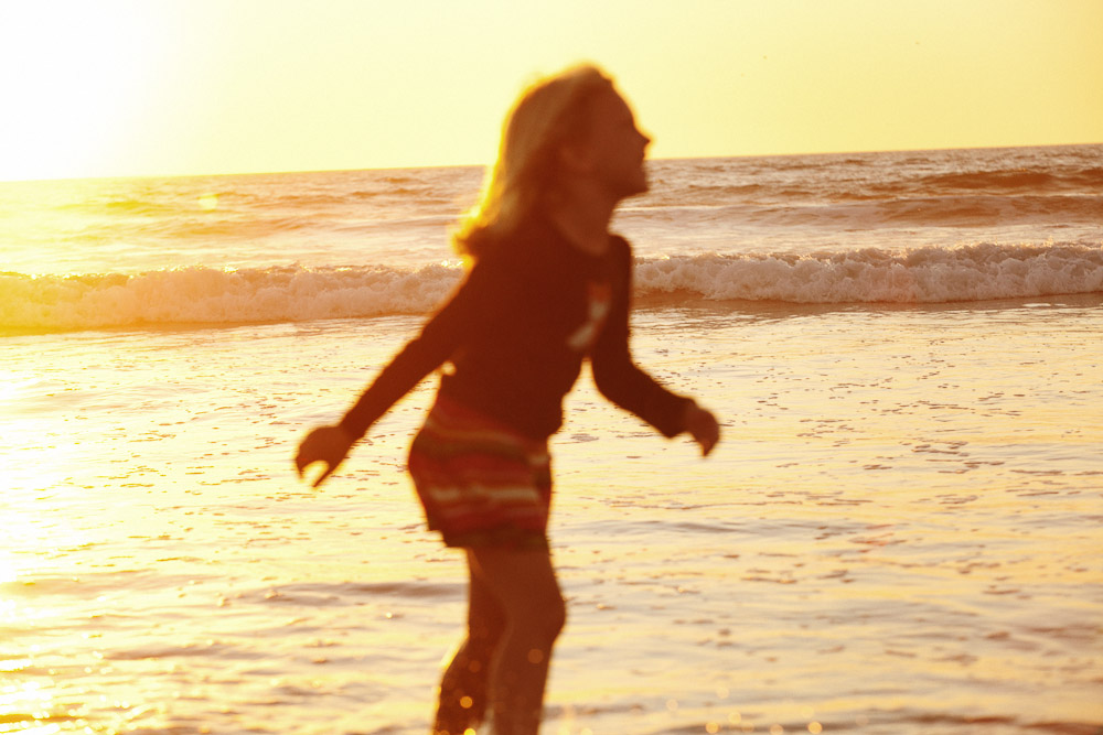 Young girl at Mission Beach, California at dusk.