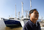 Captain Michael Nguyen stands on his fishing boat in Venice, La. Local fishermen worried about how their industry would withstand the spill.