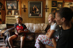 Austin Verdin, 11, left, sits in his family's living room with his sister Sabre, 5, second from right, and his mother Elana in Galliano, La. Austin and Sabre's father was working as a fisherman until local waters were closed because of the oil spill. He fell back on his commercial driver's license and took a job with a trucking firm, which kept him away from home more often.