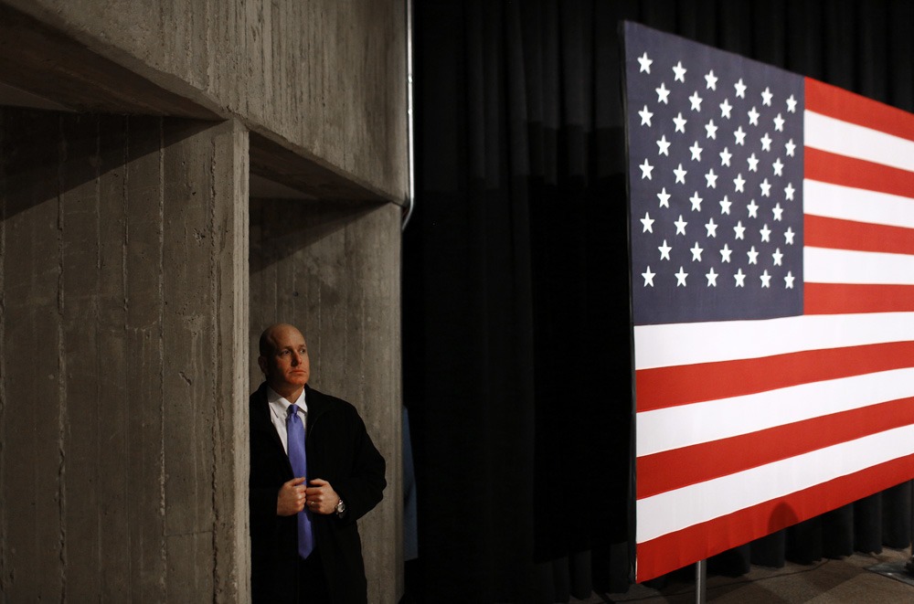 A U.S. Secret Service agent stands off stage before a campaign event featuring Democratic presidential candidate Hillary Clinton at Iowa State University in Ames, Iowa.