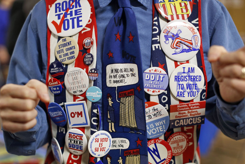 John Olsen chats as he wears a vest covered in political buttons before listening to Democratic presidential candidate, former Maryland Gov. Martin O'Malley, and others seeking political office address members of the Ankeny Area Democrats at a UAW Hall in Des Moines, Iowa.