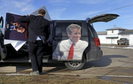 Jonathan Van Norman, a field staffer for Republican presidential candidate, Sen. Rand Paul, R-Ky., loads campaign material into a van after a town hall featuring Paul at the National Sprint Car Hall of Fame and Museum in Knoxville, Iowa.