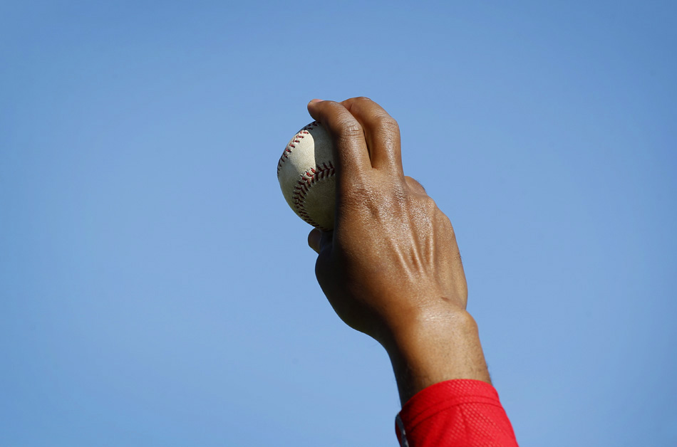 Pedro Martinez, special assistant to the Boston Red Sox general manager, grips a baseball as he mentors pitchers during a practice in Fort Myers, Fla.