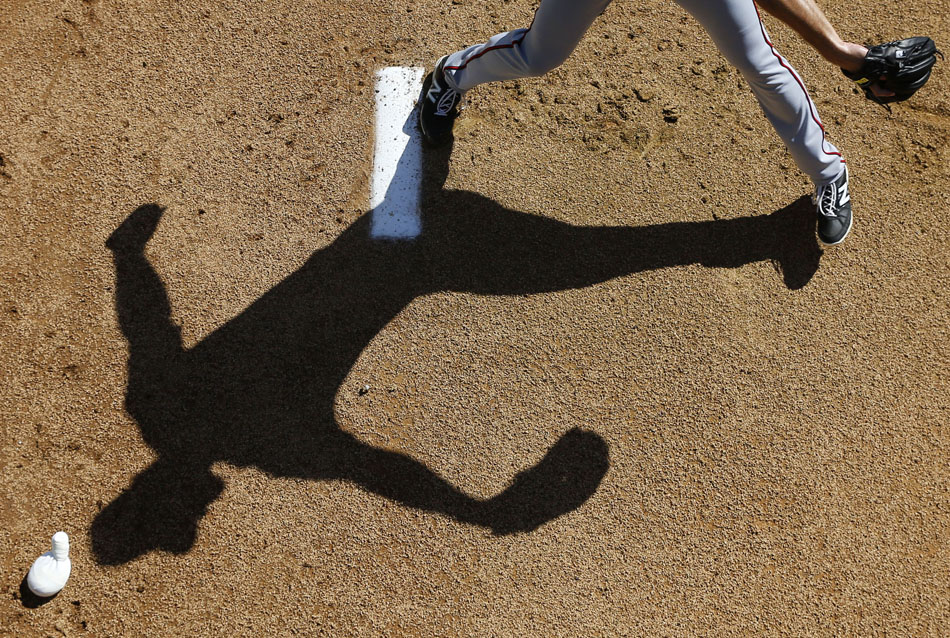 Minnesota Twins pitcher J.T. Chargois throws a pitch during a workout in Fort Myers, Fla.
