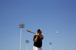 Baltimore Orioles third base coach Bobby Dickerson swings at a ball as he leads a drill in Sarasota, Fla.